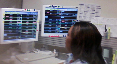 Figure 2. Remote telemetry technician monitoring patient ECG signals.